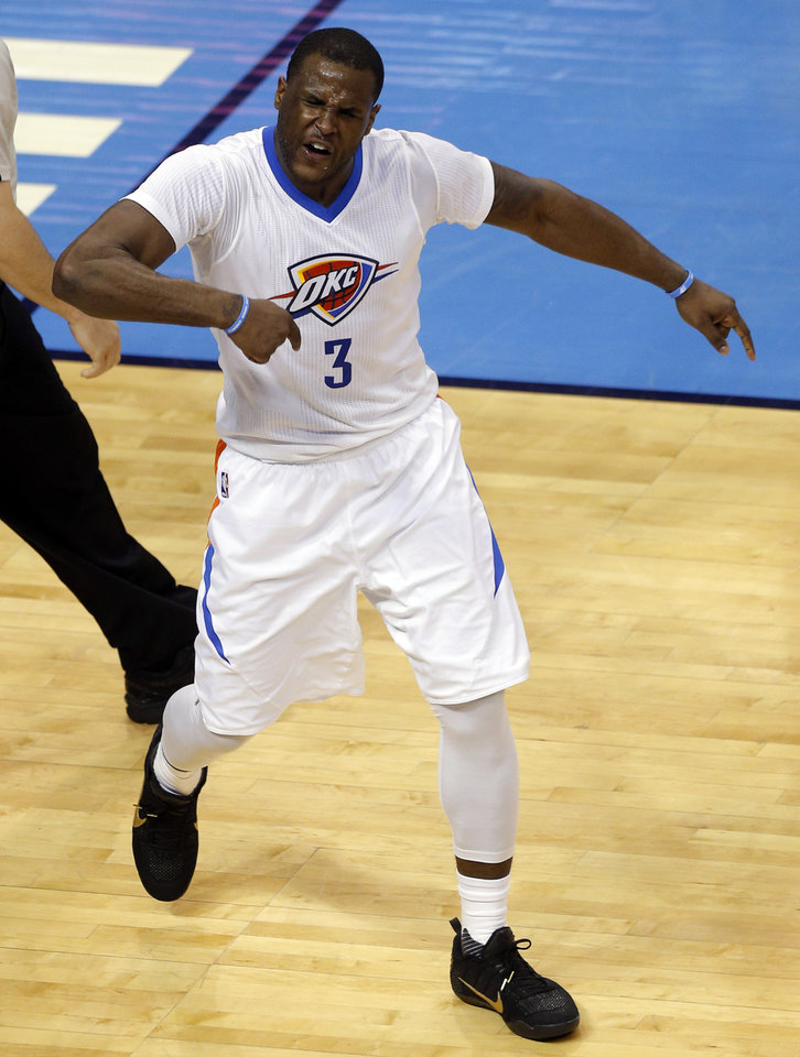 Photo - Oklahoma City's Dion Waiters (3) celebrates a basket and foul during Game 2 in the first round of the NBA playoffs between the Oklahoma City Thunder and the Dallas Mavericks at Chesapeake Energy Arena in Oklahoma City, Monday, April 18, 2016. Photo by Sarah Phipps, The Oklahoman