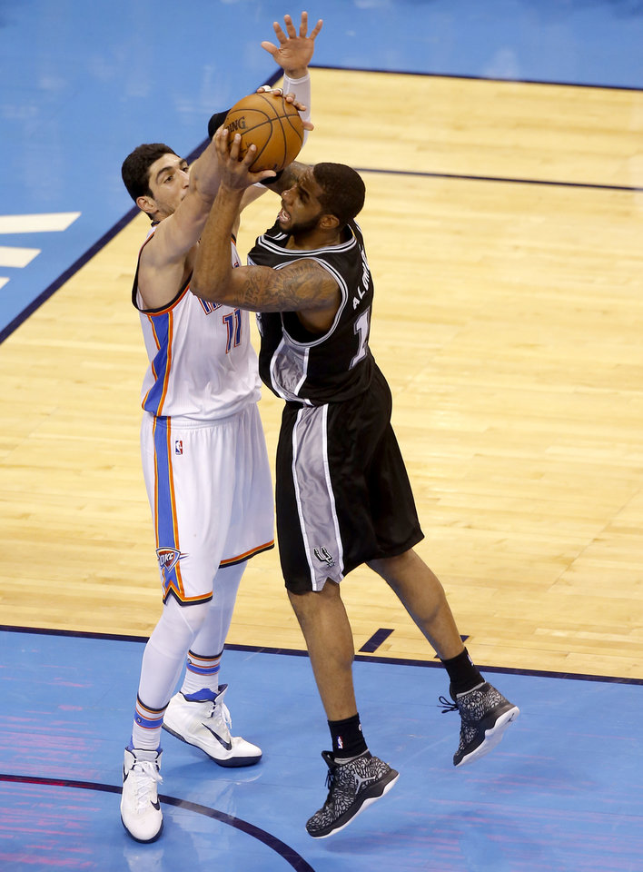 Photo - Oklahoma City's Enes Kanter (11) fouls San Antonio's LaMarcus Aldridge (12) during Game 4 of the Western Conference semifinals between the Oklahoma City Thunder and the San Antonio Spurs in the NBA playoffs at Chesapeake Energy Arena in Oklahoma City, Sunday, May 8, 2016. Photo by Sarah Phipps, The Oklahoman