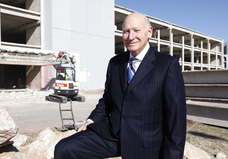 Photo -  Developer Dick Tanenbaum is shown in front of the smaller of the two Lincoln Plaza hotel buildings as it was being converted into offices for the Oklahoma Healthcare Authority in this 2013 photo. [The Oklahoman Archives]