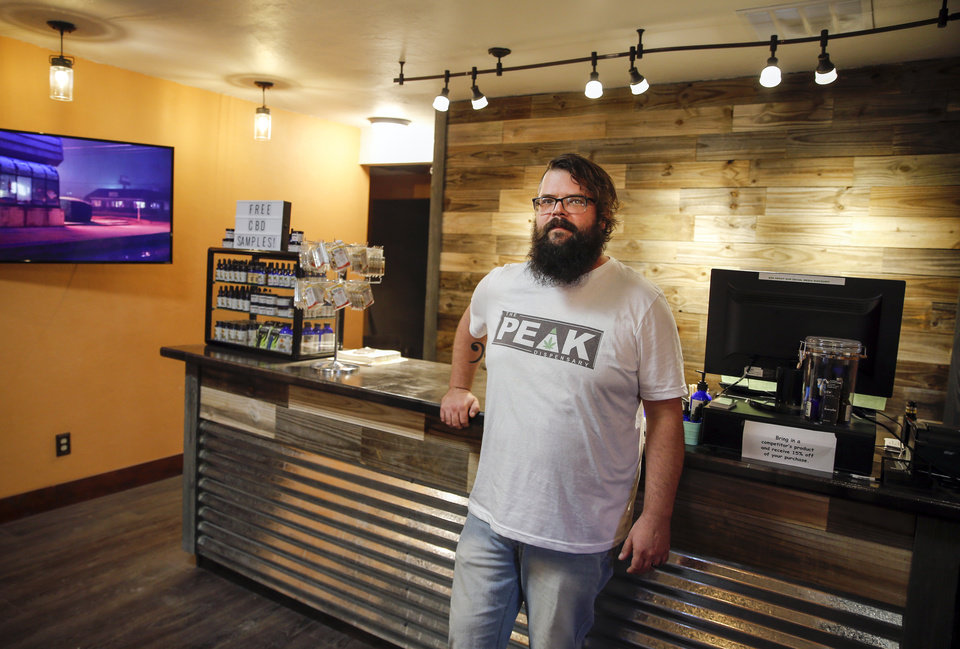 Photo -  The Peak Dispensary Manager Brodee Nucci stands inside the business at 2120 NW 23 on Wednesday. The business is currently selling CBD products and preparing to sell medical marijuana. [Photo by Nate Billings, The Oklahoman]