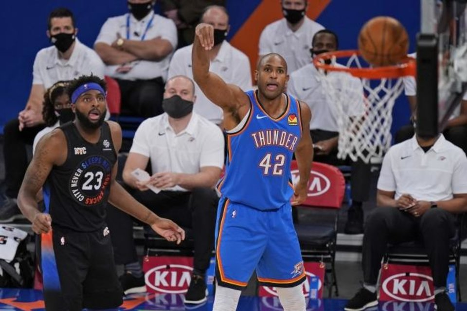 Photo -  Thunder center Al Horford (42) sinks a basket as Knicks center Mitchell Robinson (23) looks on during OKC's 101-89 win Friday in New York. [AP Photo/Seth Wenig, Pool]