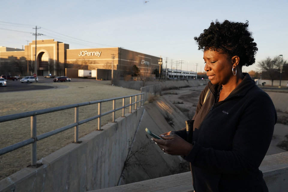 Photo - Sena Franklin waits for news from her sons girlfriend who was hiding inside the mall after the shooting at Penn Square Mall in Oklahoma City, Oklahoma December 19, 2019. Nick Oxford, for The Oklahoman