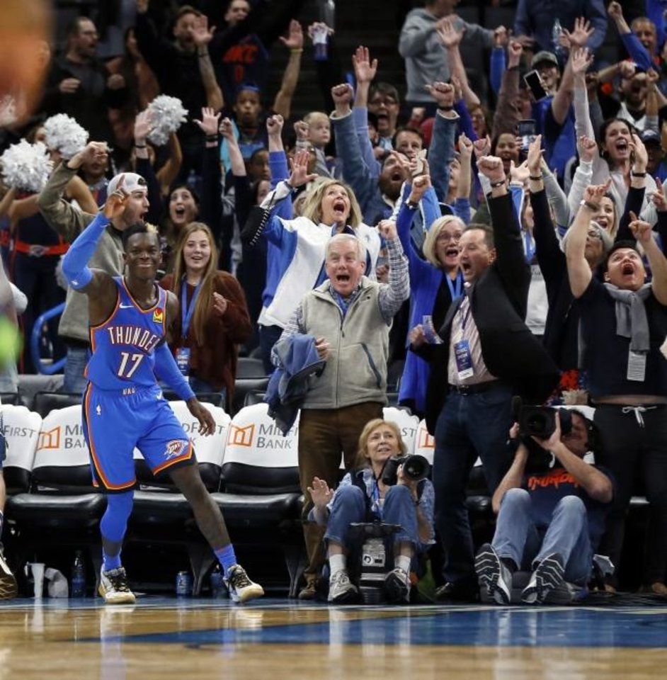 Photo -  Dennis Schroder (17) celebrates, along with Thunder fans, his game-tying basket to force overtime in an eventual 139-127 win Friday night against the Timberwolves. [Nate Billings/The Oklahoman]