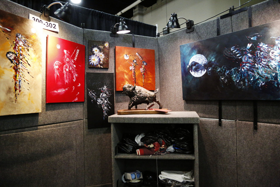 Photo - Art work from Clacy Gray on display at the first day of the 2019 Red Earth Festival at the Cox Convention Center in Oklahoma City, Oklahoma Friday, June 7, 2019.  [Paxson Haws/The Oklahoman]