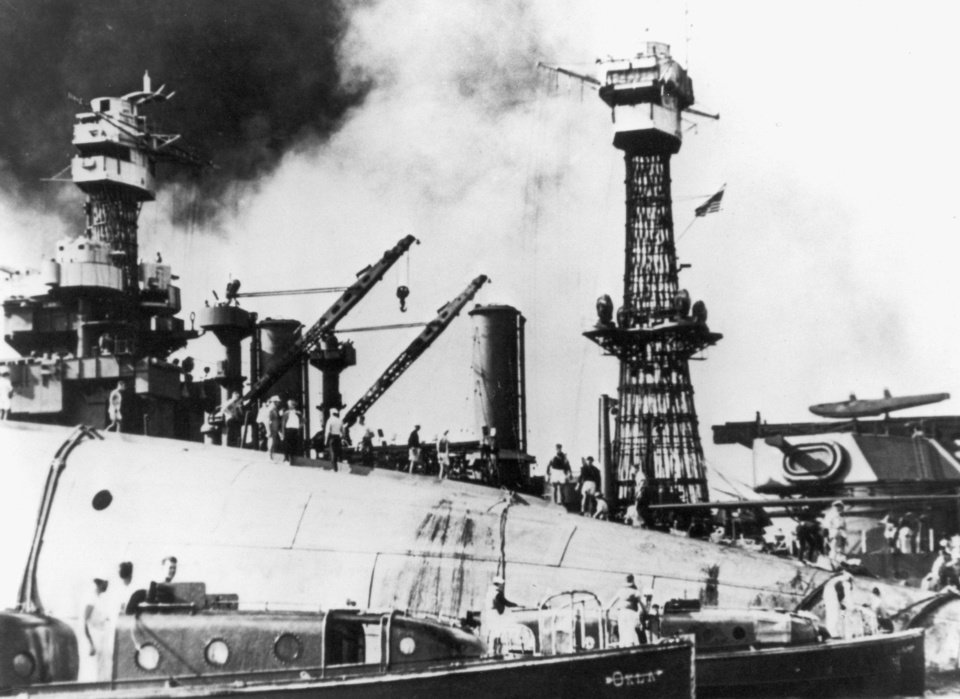 Photo - Rescue crews are shown working in 1941 on the upturned hull of the USS Oklahoma, which was capsized in Pearl Harbor after being blasted by Japanese planes. U.S. Navy Photo  US NAVY PHOTO: 1941
