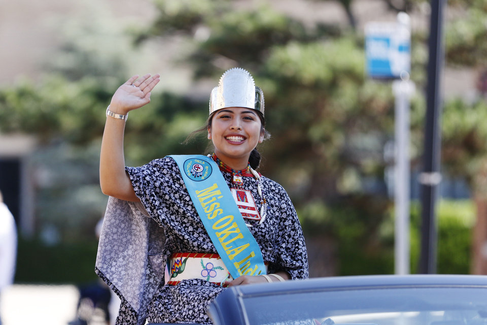 Photo - A tribal princess waves to the crowd during the parade for the 2019 Red Earth Festival in downtown Oklahoma City, Oklahoma Saturday, June 8, 2019.  [Paxson Haws/The Oklahoman]
