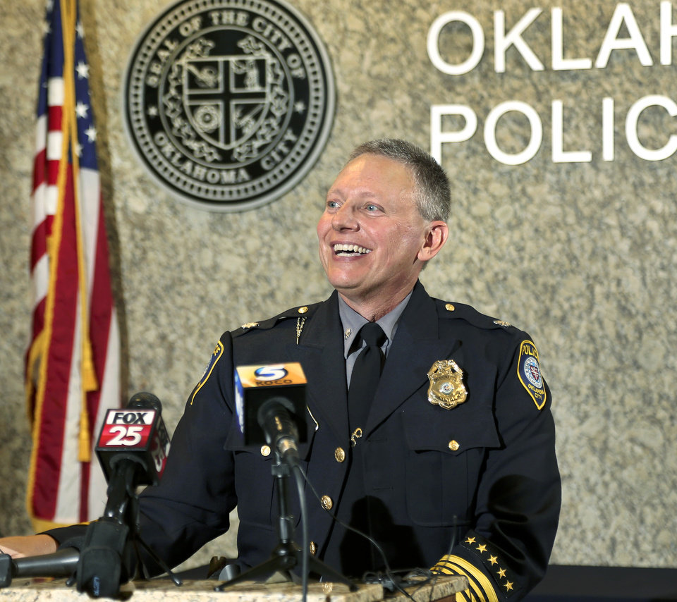 "Photo - Wearing his department's Class-A uniform, Wade Gourley appears before fellow officers, commanders and administrative personnel at a news conference at police headquarters Monday, July 8, 2019, after being introduced by City Manager Craig Freeman as the new chief of the Oklahoma City Police Department. Gourley has been an Oklahoma City police officer for 30 years and was serving as one of the police department's four deputy chiefs before being promoted to chief. He succeeds former Police Chief Bill Citty, who retired in May after 15 years as head of the department.  Freeman said ""Chief Gourley fits the mold of what we're looking for: he's open, honest, innovative and experienced, and he will lead by example. I'm confident he will lead our police department to continue to serve and protect all residents in a fair and equitable manner."" Gourley is Oklahoma City's  50th chief. He will be responsible for the 1,235 uniformed officers and 304 other staff members in the police department.  [Jim Beckel/The Oklahoman]"