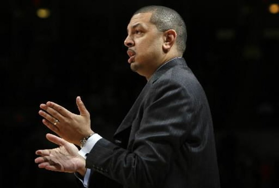 Photo - OU's head coach Jeff Capel coaches his team in the second round game of the Big 12 Men's Basketball Championships game between the University of Oklahoma and Oklahoma State University at the Ford Center on Thursday, March 12, 2009, in Oklahoma City, Okla. PHOTO BY SARAH PHIPPS, THE OKLAHOMAN