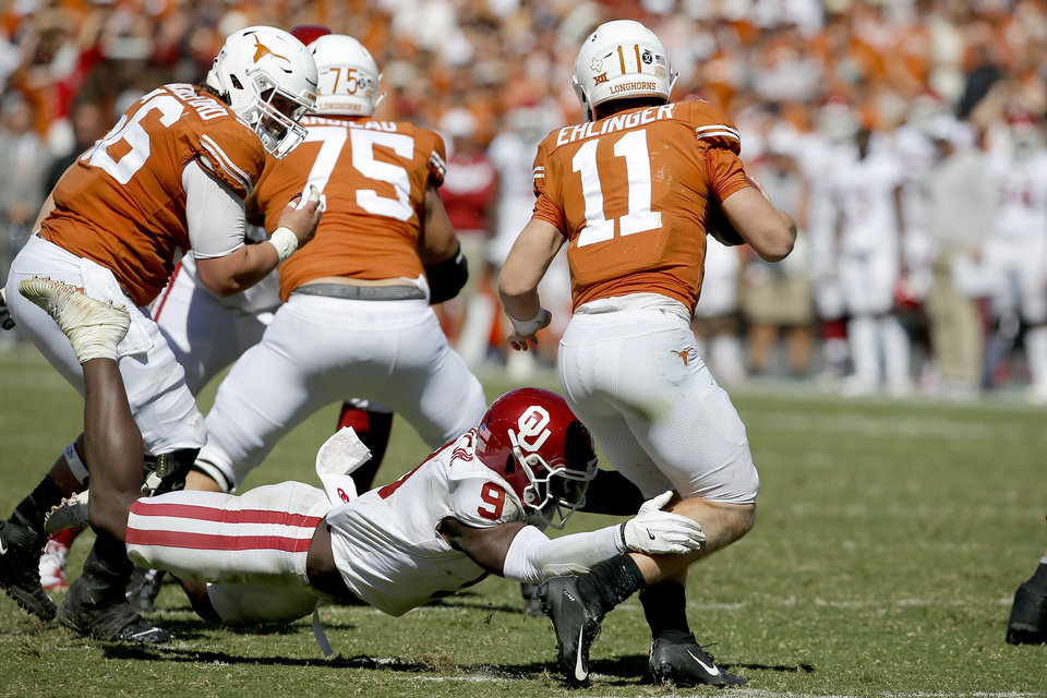 Photo - Oklahoma linebacker Kenneth Murray (9) brings down Texas quarterback Sam Ehlinger (11) during the Red River Showdown college football game between the University of Oklahoma Sooners (OU) and the Texas Longhorns (UT) at Cotton Bowl Stadium in Dallas, Saturday, Oct. 12, 2019. Oklahoma won 34-27. [Bryan Terry/The Oklahoman]
