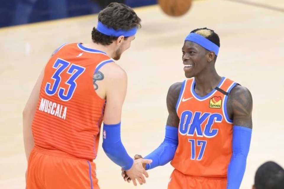 Photo -  Thunder forward Mike Muscala (33) and guard Dennis Schroder (17) celebrate during the fourth quarter of their 121-106 win Saturday at Cleveland. [David Richard/USA TODAY Sports]