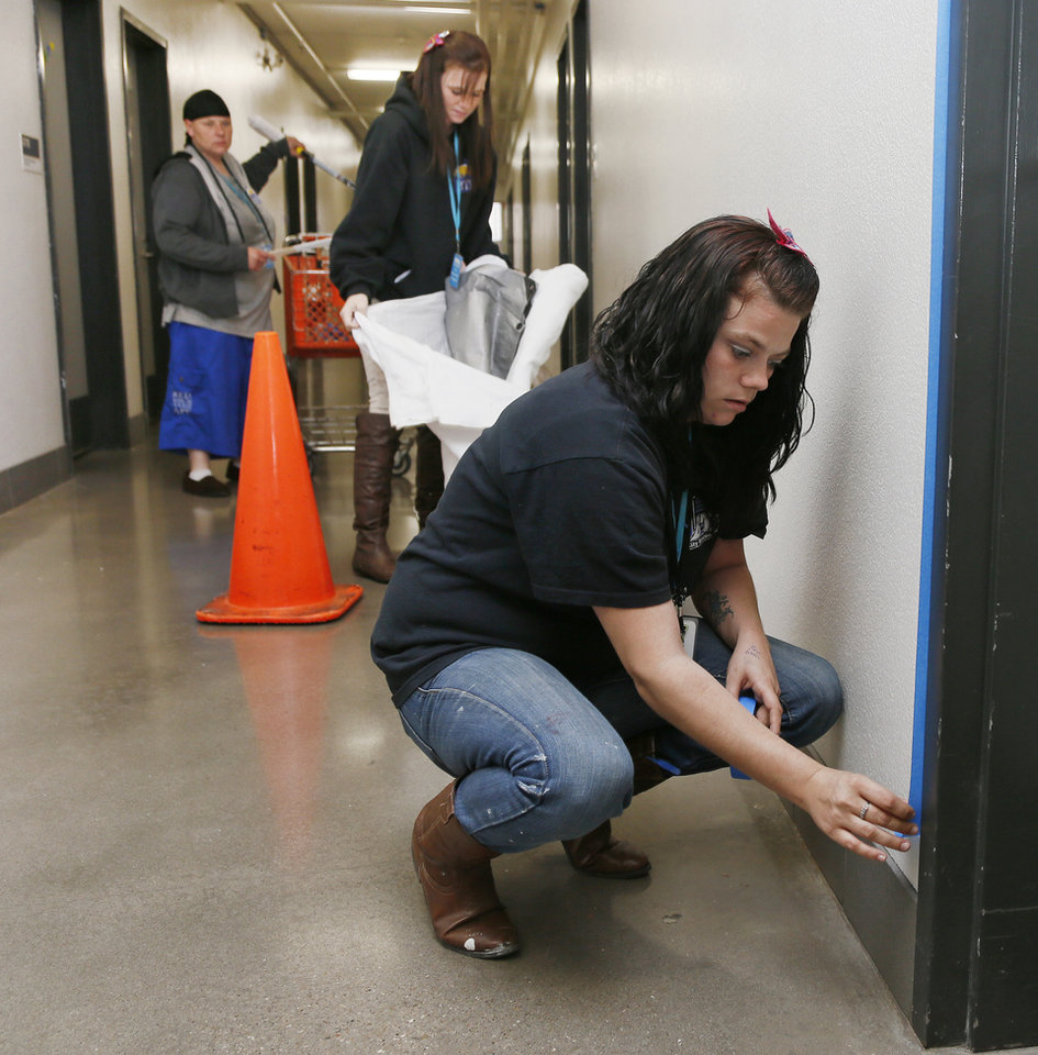Photo -  Krysten Gonzalez, front, prepares to paint a hallway at the City Rescue Mission in 2014. At the time, Gonzalez was a part of a recovery program at the rescue mission. Gonzalez died Tuesday after being found unresponsive at the Oklahoma County jail. [Photo by Nate Billings, The Oklahoman Archives]