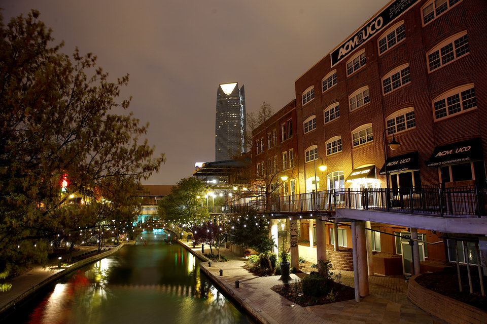Photo - Empty sidewalks along the Bricktown Canal in Oklahoma City, Friday, March 27, 2020. [Bryan Terry/The Oklahoman]