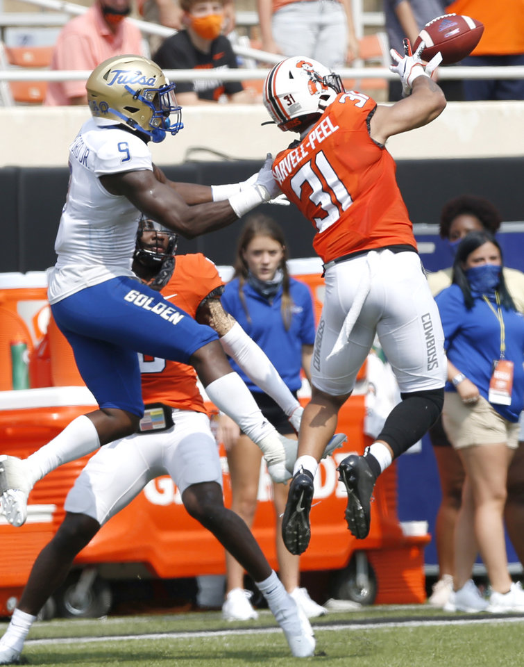 Photo - Oklahoma State's Kolby Harvell-Peel intercepts a pass with 8 seconds left in the game against Tulsa during their first game of the season at Boone Pickens Stadium in Stillwater on Saturday, September 19, 2020. JOHN CLANTON, TULSA WORLD