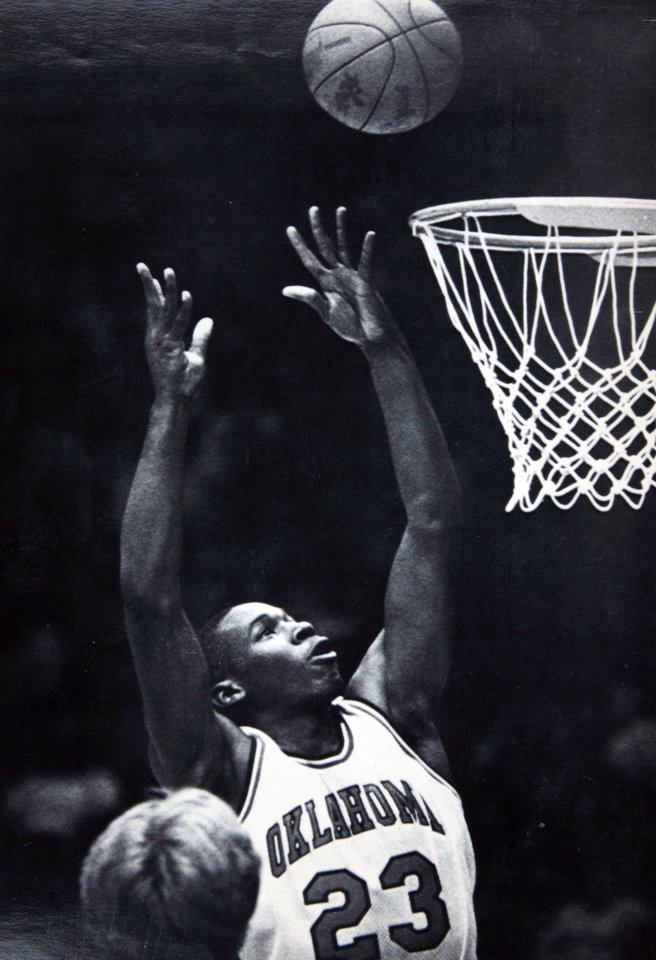 Photo - Former OU basketball player Wayman Tisdale. NORMAN, Okla., Dec. 24 - HIGH SCORER--University of Oklahoma forward Wayman Tisdale (23) drives in for a shot during first period action against the University of Illinois. The Sooner freshman was the game's high scorer with 34 points. Oklahoma won the contest 101-75. (AP Laserphoto) Staff photo by David Longstreath. Photo taken 12/24/1982, Photo published 10/31/1983 in The Daily Oklahoman. ORG XMIT: KOD