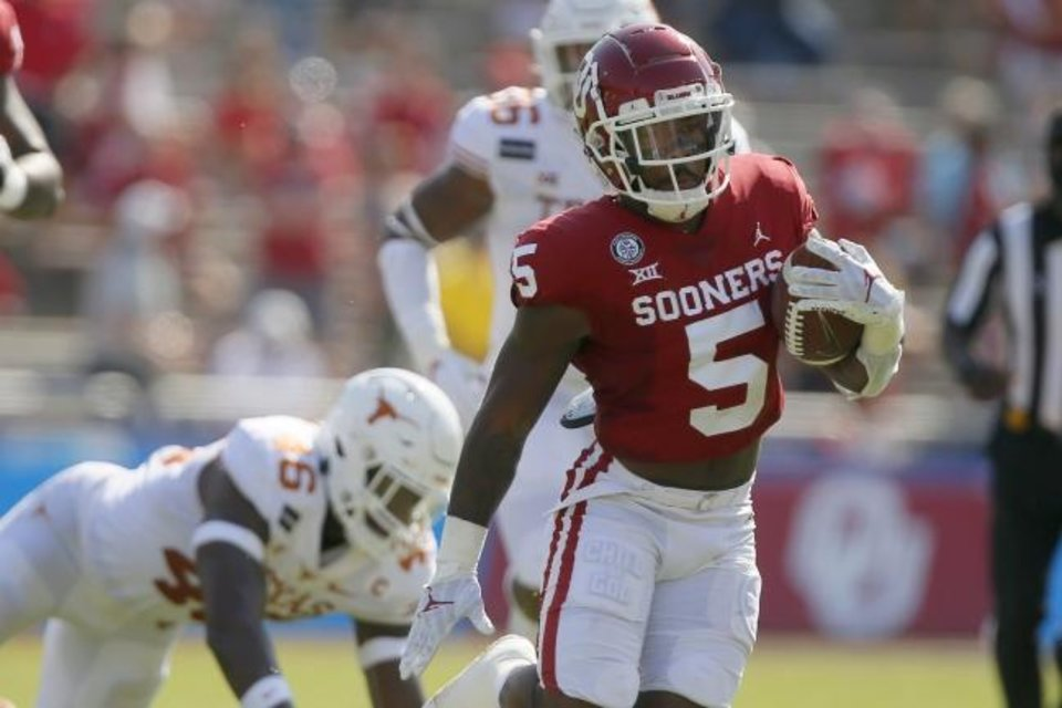 Photo -  OU junior running back T.J. Pledger (5) has averaged 4.8 yards per carry this season. [Bryan Terry/The Oklahoman]
