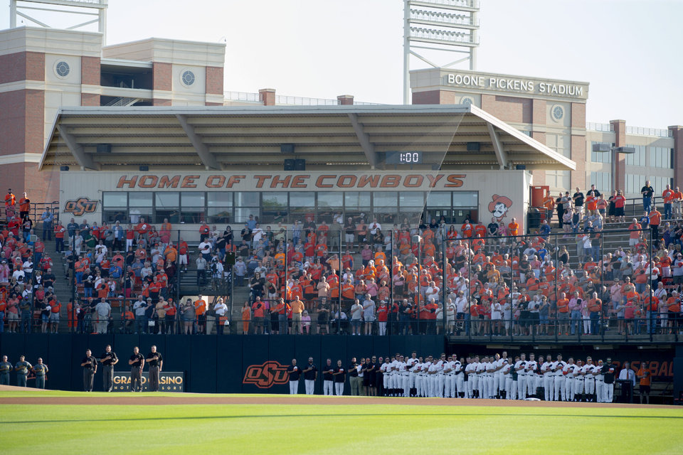 Photo - Oklahoma State baseball players stand during the national anthem before the final scheduled baseball series at Allie P. Reynolds Stadium between Oklahoma State and Baylor in Stillwater, Okla., Thursday, May 16, 2019.  [Bryan Terry/The Oklahoman]