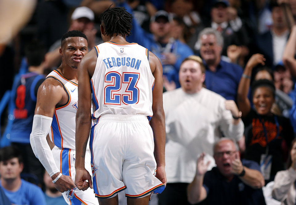Photo - Oklahoma City's Russell Westbrook (0) celebrates a dunk with Terrance Ferguson (23) during the NBA game between the Oklahoma City Thunder and the LA Clippers at the Chesapeake Energy Arena, Tuesday, Oct. 30, 2018. OSU won 38-35. Photo by Sarah Phipps, The Oklahoman