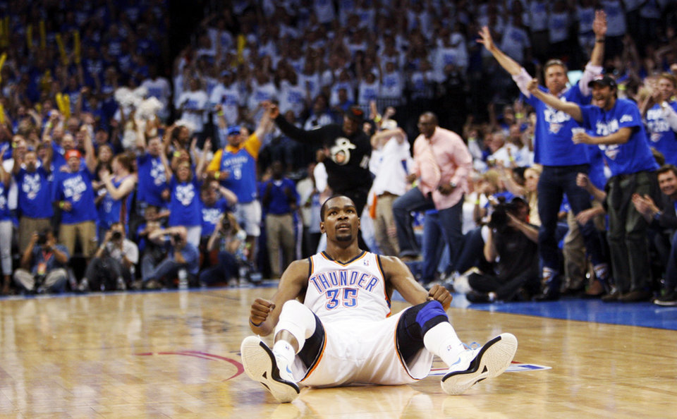 Photo - Oklahoma City's Kevin Durant (35) sits on the court after making a basket and being fouled in the fourth quarter during Game 4 of the Western Conference Finals between the Oklahoma City Thunder and the San Antonio Spurs in the NBA playoffs at the Chesapeake Energy Arena in Oklahoma City, Saturday, June 2, 2012. Oklahoma City won, 109-103. Photo by Nate Billings, The Oklahoman
