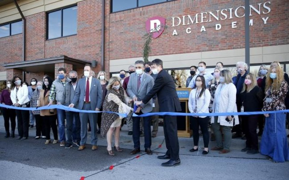 Photo -  Officials cut a ribbon for the for Norman Public Schools' Dimensions Academy building that houses the district's alternative education program in Norman, Okla., Tuesday, Jan. 5, 2021. [Sarah Phipps/The Oklahoman]