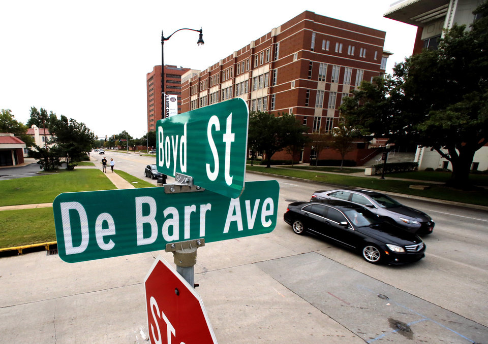 Photo - The DeBarr street sign on Boyd Street across the street from the University of Oklahoma (OU) is seen on Thursday, Oct. 5, 2017 in Norman, Okla.  Photo by Steve Sisney, The Oklahoman
