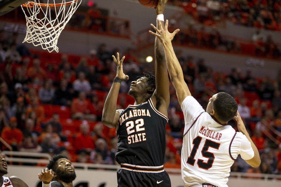 Photo -  Oklahoma State's Kalib Boone, left, shoots a layup on Saturday. Boone was named the Big 12's Newcomer of the Week. [AP Photo/Mitch Alcala]