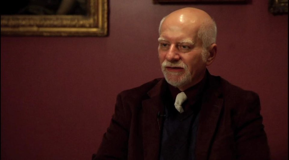 Photo -  Chris Claremont is shown in a screenshot from the documentary film