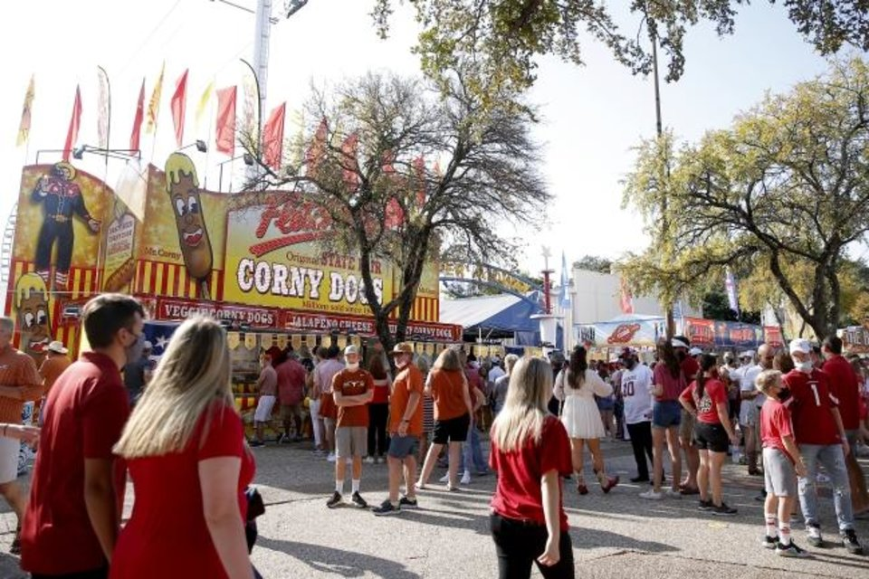 Photo -  Fans gather outside Cotton Bowl Stadium before the Red River Showdown on Saturday in Dallas. Fletcher's corny dogs were open for business. [Bryan Terry/The Oklahoman]