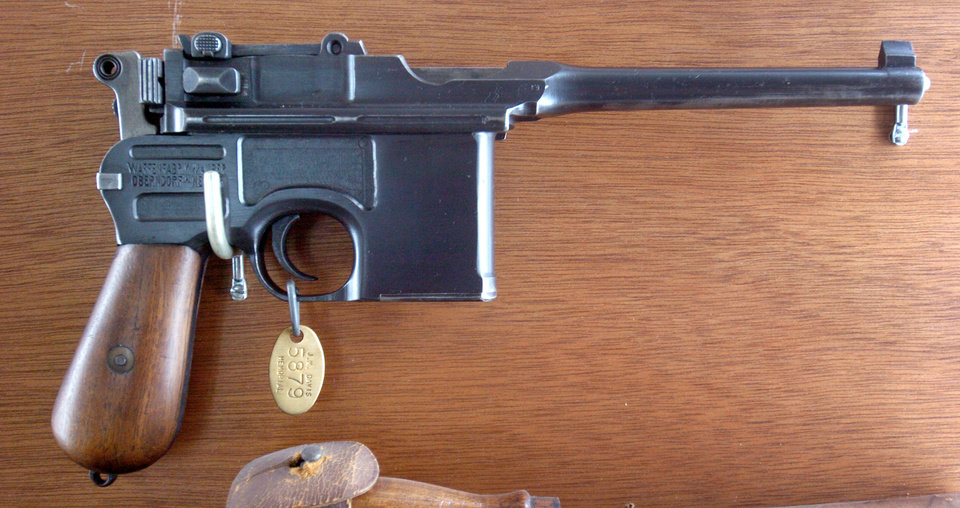 Photo - Claremore, Okla. 6/14/05       OUTLAW, OUTLAWS, GUN, GUNS: A 9mm German Mauser owned by bank robber Al Spencer who was known as king of Oklahoma bank robbers, on display at the J.M. Davis Arms & Historical Museum. By Paul Hellstern/The Oklahoman