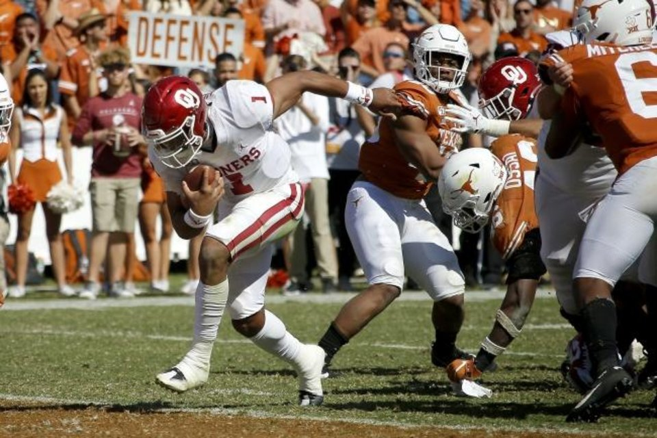 Photo -  Jalen Hurts runs a touchdown Saturday en route to his 131 rushing yards — the most ever by a college quarterback at Cotton Bowl Stadium and the most ever by an Oklahoma quarterback against Texas. [Bryan Terry/The Oklahoman]
