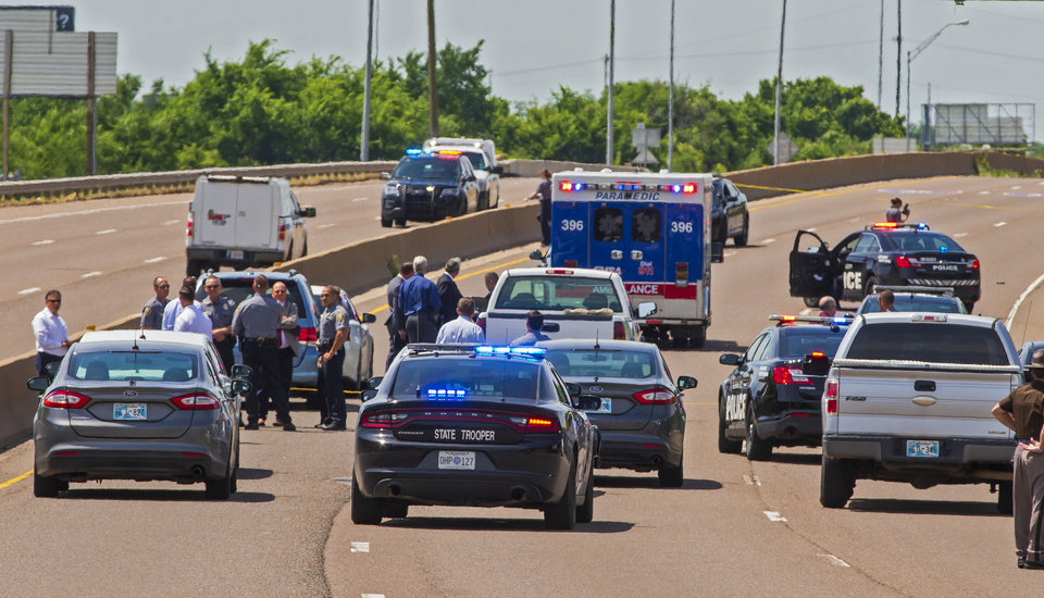 Photo - Crews work the scene a fatal officer involved shooting on I-35 near NE 10th St. in Oklahoma City Okla. on Monday, June 10, 2019. [Chris Landsberger/The Oklahoman]