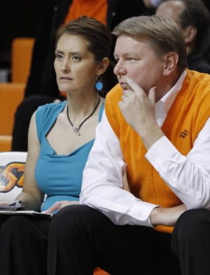Photo - OSU Women's basketball coach Kurt Budke and his assistant coach Miranda Serna during an exhibition women's NCAA college basketball game between the Oklahoma State University Cowboys and the Fort Hays State Tigers at Gallagher-Iba Arena in Stillwater, Okla., Wednesday, Nov. 9, 2011. Photo by Bryan Terry