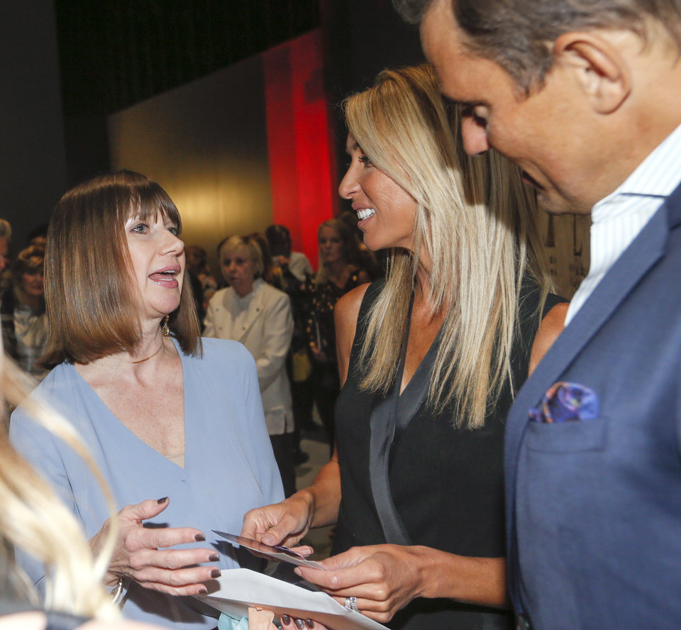 Photo -  S.J. O'Hara, of Norman, talks with celebrities Giuliana and Bill Rancic after the couple's presentation at the Junior League of Oklahoma City's