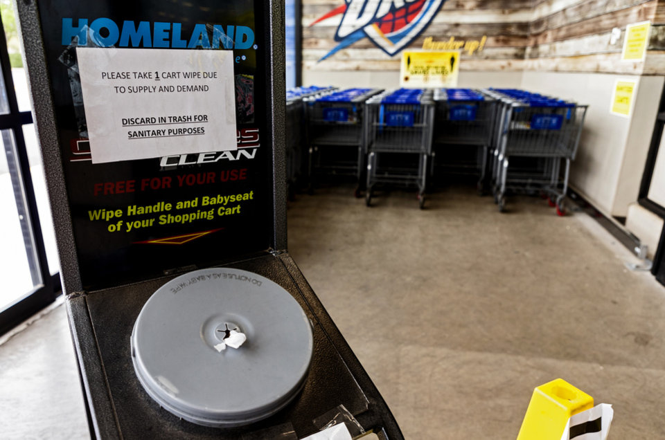 Photo - Sanitizing wipes are available for customer use while shopping in the Homeland located at 1108 NW 18th St. in Oklahoma City, Okla. on Monday, April 13, 2020. The store has taken extra steps to help protect its employees and customers during the coronavirus pandemic.   [Chris Landsberger/The Oklahoman]
