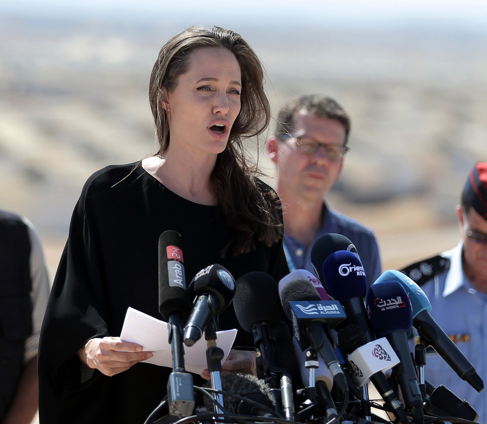 Photo - Actress and UN refugee agency envoy special envoy Angelina Jolie talks during a visit to a Syrian refugee camp in Azraq in northern Jordan on Friday, Sept. 9, 2016. She is calling on the international community to end the protracted Syrian civil war and increase support for refugees across the region. Five years into the Syrian conflict, she said brutal violence rages while the UN Security Council remains divided on a political solution. (AP Photo/Ahmad Alameen)