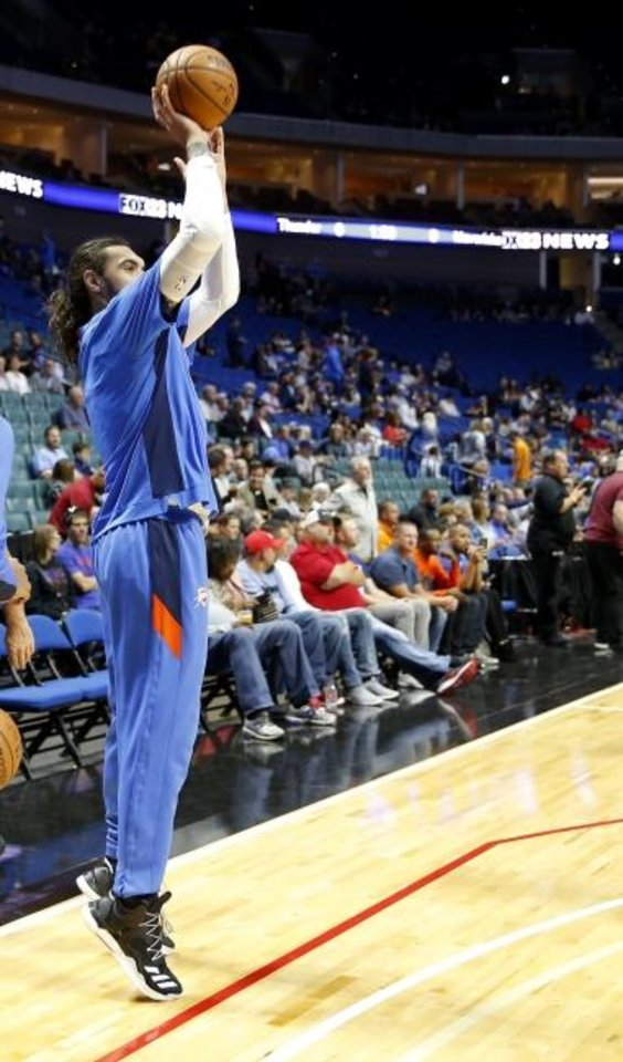 Photo -  Oklahoma City's Steven Adams shoots a 3-point basket during warmups before a preseason against the Dallas Mavericks on Oct. 8 in Tulsa.  The 3-point shot could become a part of Adams' game. [Sarah Phipps/The Oklahoman]