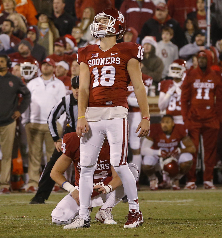 Photo - Oklahoma's Michael Hunnicutt (18) watches as he misses a field goal in overtime during a Bedlam college football game between the University of Oklahoma Sooners (OU) and the Oklahoma State Cowboys (OSU) at Gaylord Family-Oklahoma Memorial Stadium in Norman, Okla., Saturday, Dec. 6, 2014. Photo by Bryan Terry, The Oklahoman
