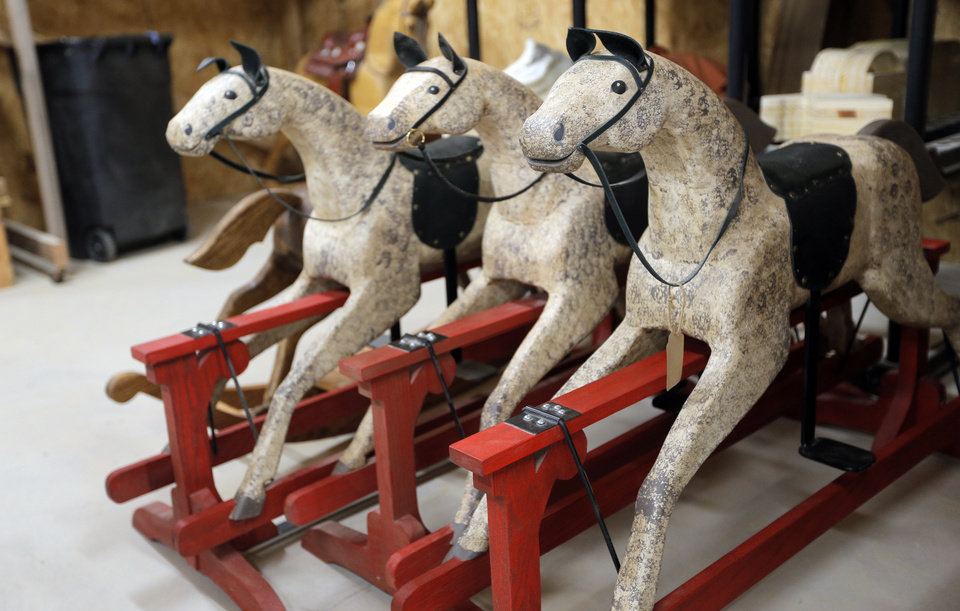 Photo -  These horses, which Jackie Wilson calls Secretariat, are the type of hand-made horse she built for President Barka Obama and his wife, Michelle, to give to Prince George. PHOTO BY SARAH PHIPPS, THE OKLAHOMAN.     SARAH PHIPPS - SARAH PHIPPS