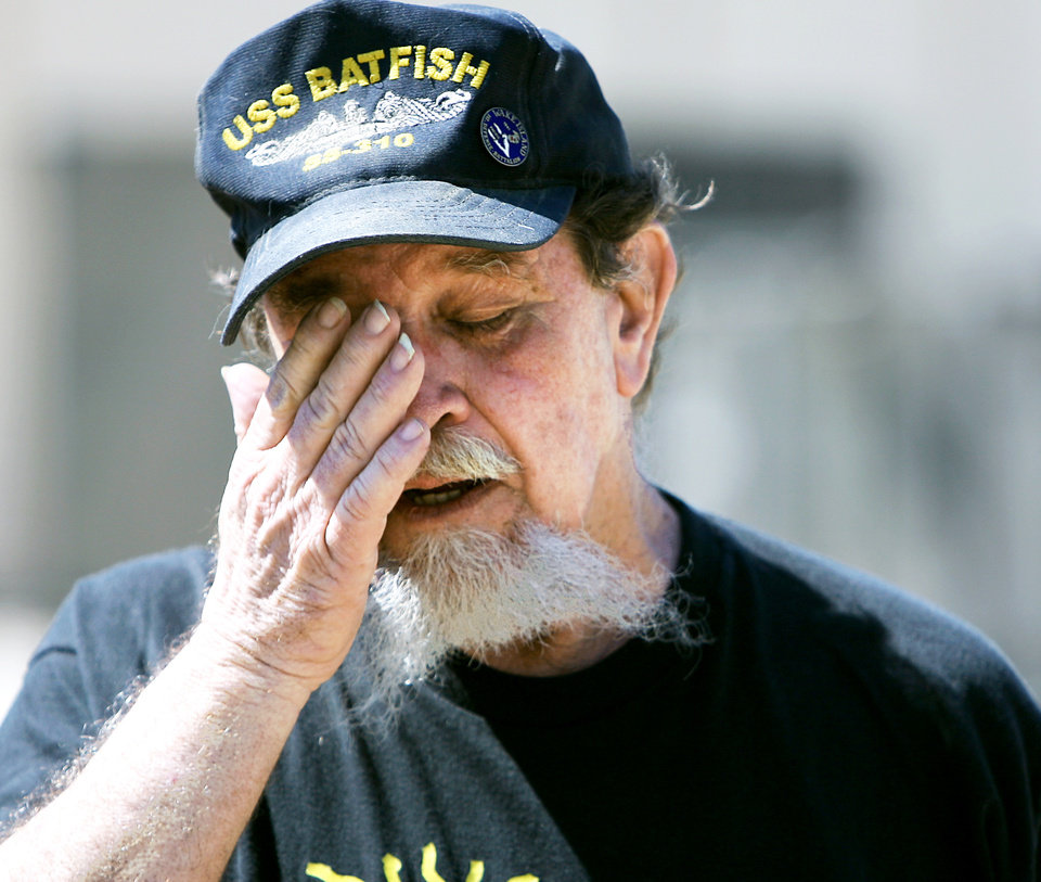 Rod Mish, a volunteer at the USS Batfish Submarine War Memorial Park and Military Museum, wipes away tears Monday as he watches a plane deliver a mast at ...