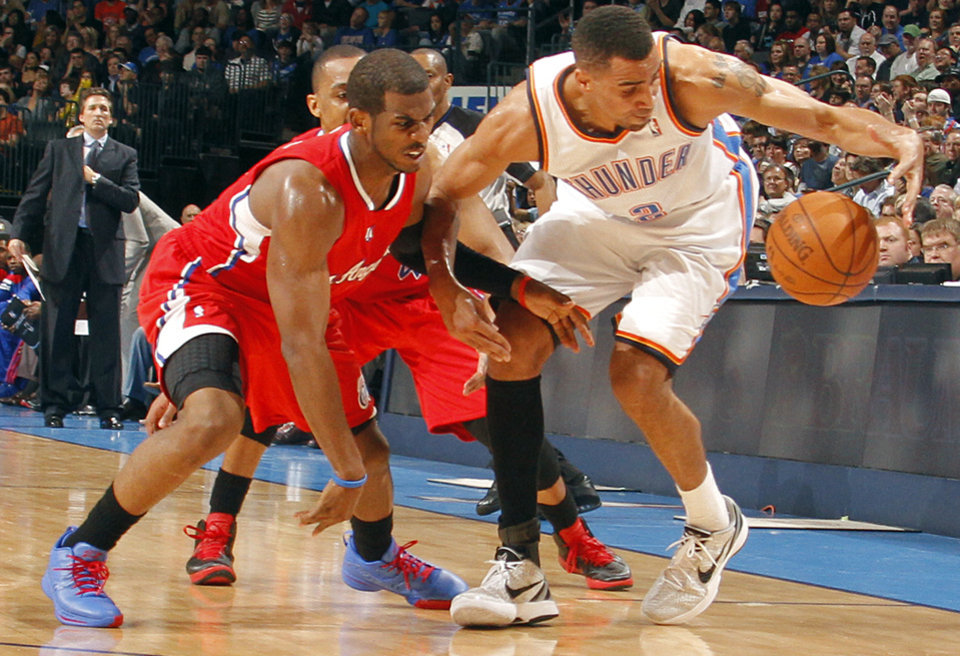 Photo - Oklahoma City Thunder shooting guard Thabo Sefolosha (2) gets a steal on Los Angeles Clippers point guard Chris Paul (3) during the NBA basketball game between the Oklahoma City Thunder and the Los Angeles Clippers at Chesapeake Energy Arena on Wednesday, March 21, 2012 in Oklahoma City, Okla.  Photo by Chris Landsberger, The Oklahoman