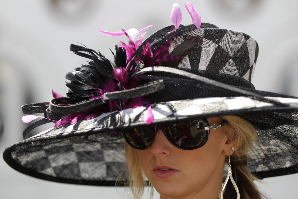 Photo - Sara Boucher, Frederickstown, Ohio wears a fancy hat in the paddocks before the 138th Kentucky Derby horse race at Churchill Downs Saturday, May 5, 2012, in Louisville, Ky. (AP Photo/Mark Humphrey)  Mark Humphrey - AP