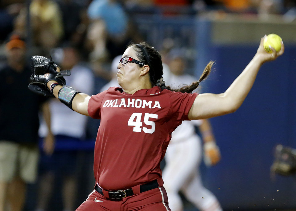 Photo - Oklahoma's Giselle Juarez (45) throws a pitch during a Women's College World Series between Oklahoma State (OSU) and Oklahoma at USA Softball Hall of Fame Stadium in Oklahoma City,  Friday, May 31, 2019.  [Sarah Phipps/The Oklahoman]