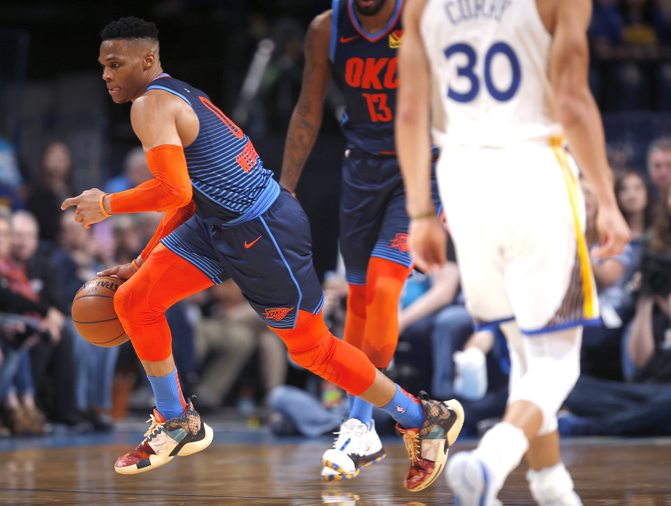 Photo - Oklahoma City's Russell Westbrook (0) gets a loose ball during the NBA basketball game between the Oklahoma City Thunder and the Golden State Warriors at Chesapeake Energy Arena,  Saturday, March 16, 2019. Photo by Sarah Phipps, The Oklahoman