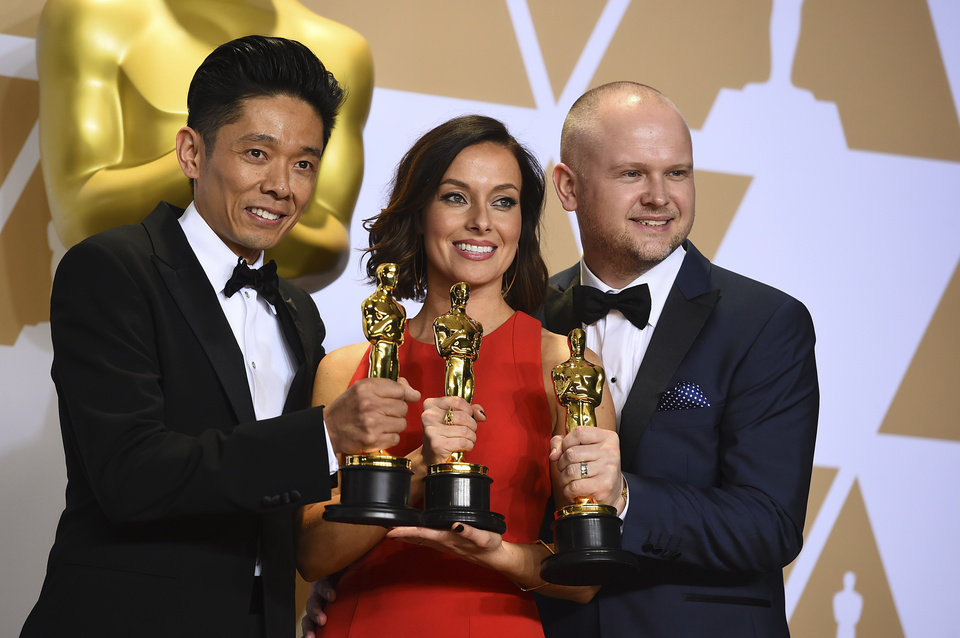 "Photo - Kazuhiro Tsuji, from left, Lucy Sibbick, and David Malinowski, winners of the award for best makeup and hairstyling for ""Darkest Hour"", pose in the press room at the Oscars on Sunday, March 4, 2018, at the Dolby Theatre in Los Angeles. (Photo by Jordan Strauss/Invision/AP)"