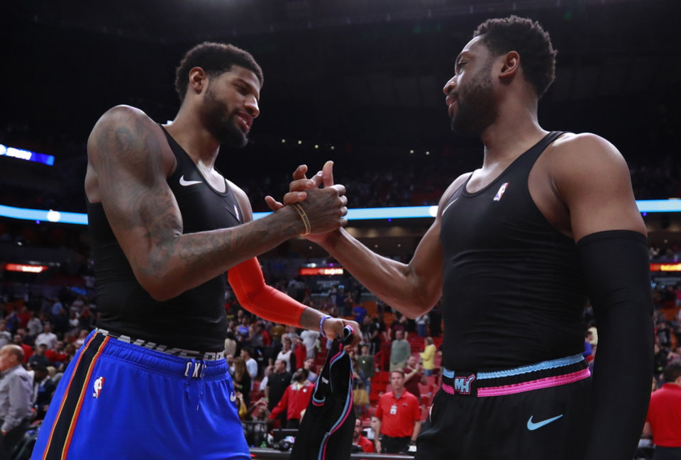 Photo -  Oklahoma City Thunder forward Paul George, left, and Miami Heat guard Dwyane Wade congratulate each other after exchanging jerseys after an NBA basketball game, Friday, Feb. 1, 2019, in Miami. (AP Photo/Wilfredo Lee)