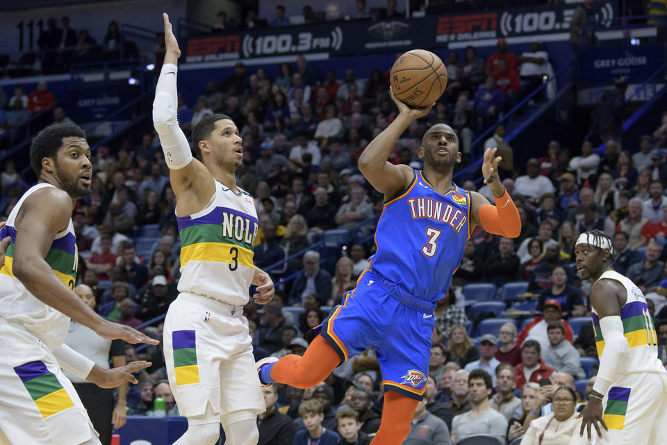 Photo - Oklahoma City Thunder guard Chris Paul (3) shoots next to New Orleans Pelicans guard Josh Hart (3) during the first half of an NBA basketball game in New Orleans, Thursday, Feb. 13, 2020. (AP Photo/Matthew Hinton)