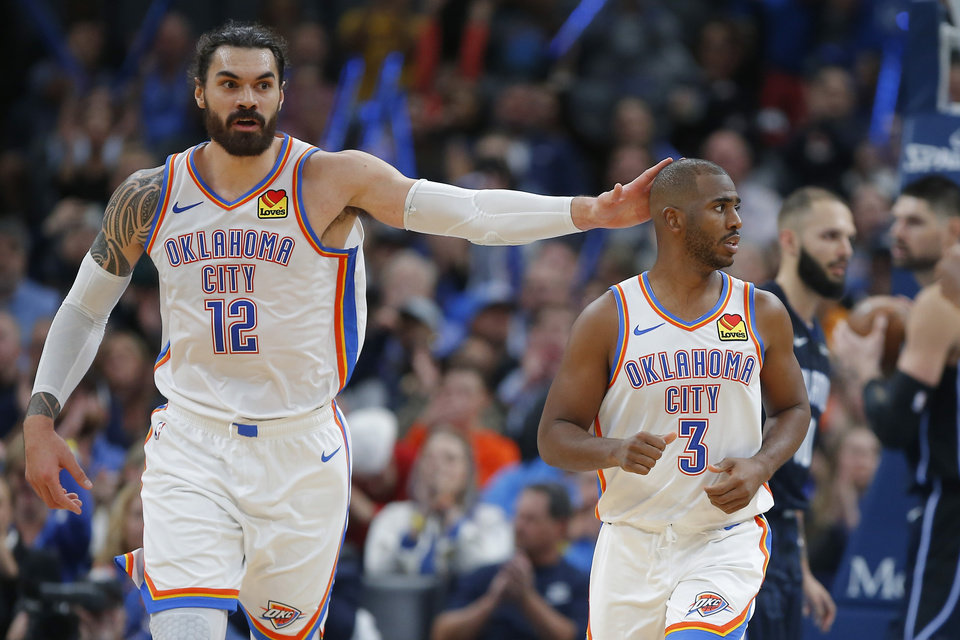 Photo - Oklahoma City's Steven Adams (12) pats Chris Paul (3) on the head during an NBA basketball game between the Oklahoma City Thunder and the Orlando Magic at Chesapeake Energy Arena in Oklahoma City, Tuesday, Nov. 5, 2019. Oklahoma City won 102-94. [Bryan Terry/The Oklahoman]