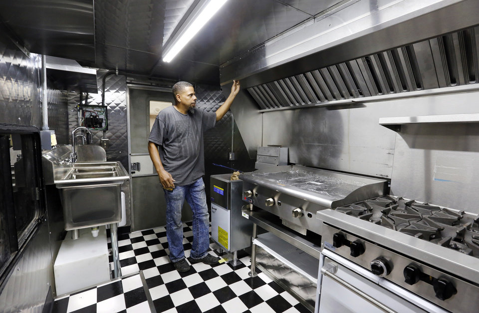Photo -  D&D Custom Built Food Trucks owner Deion Estrada stands in a nearly completed kitchen inside a food truck at his shop in Oklahoma City.