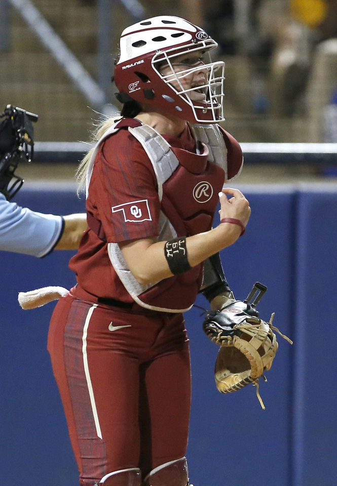 Photo - Oklahoma's Lynnsie Elam (22) cheers after a strike out during a Women's College World Series between Oklahoma State (OSU) and Oklahoma at USA Softball Hall of Fame Stadium in Oklahoma City,  Friday, May 31, 2019.  [Sarah Phipps/The Oklahoman]