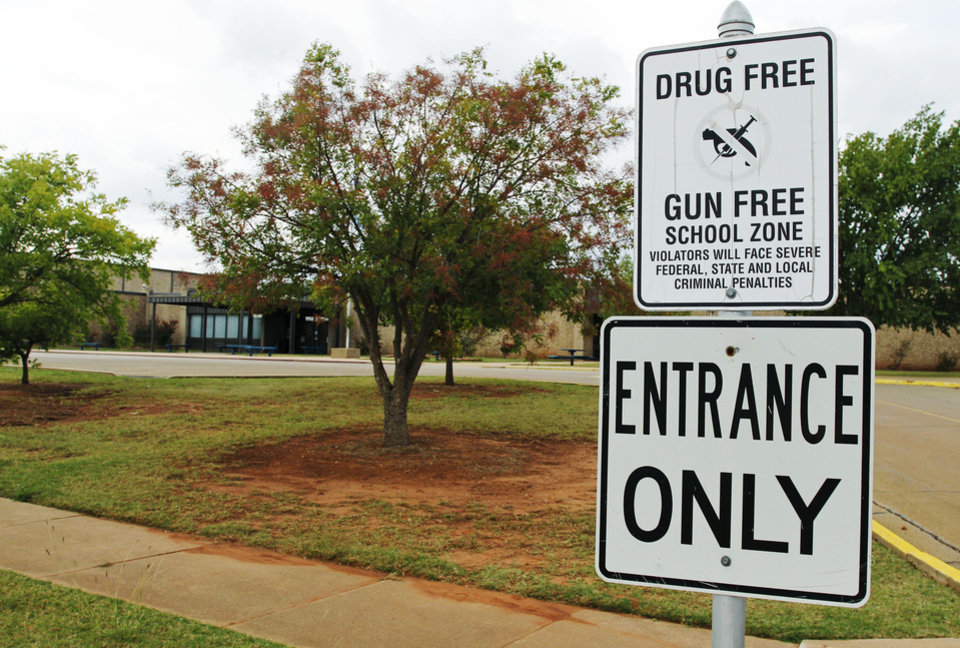 Photo - A sign declaring Stillwater Junior High School as a drug free and gun free zone is pictured outside the school in Stillwater, Okla., Wednesday, Sept. 26, 2012.  A 13-year-old student shot and killed himself in a hallway at the schooll before classes began Wednesday, police said, terrifying teenagers who feared a gunman was on the loose. (AP Photo/Sue Ogrocki) ORG XMIT: OKSO111