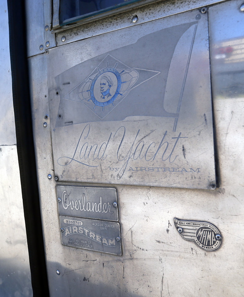 Photo -  The Airstream Land Yacht badge is seen on the side of the trailer that houses En Root. While extensive renovations were done inside to turn the trailer into a barber shop, the trailer itself remains original.